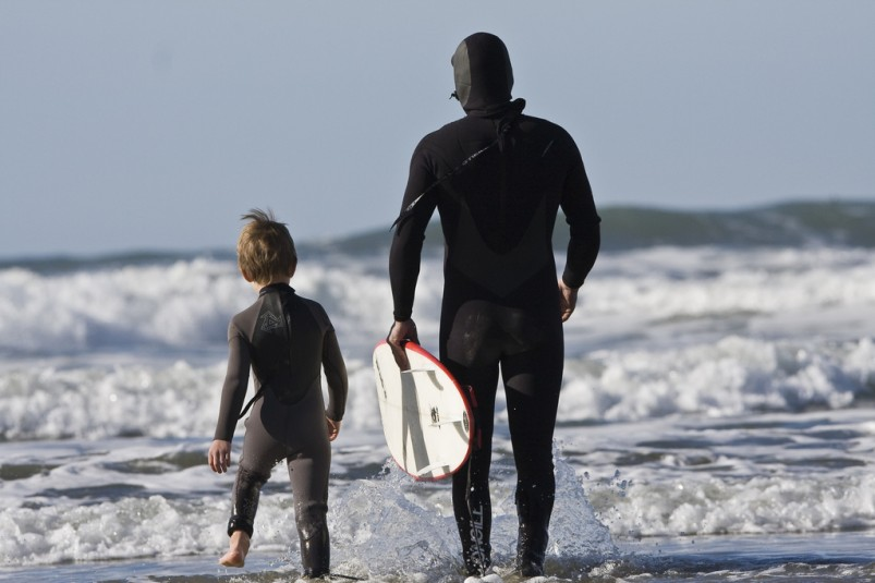 dad and grom surfing